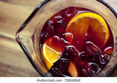 closeup photo of a fruit-packed sangria jug