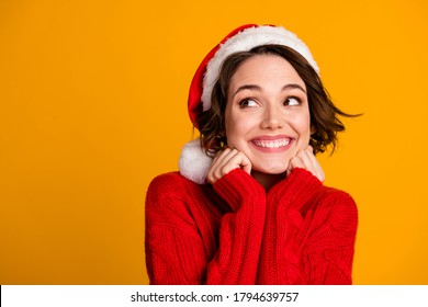 Closeup photo of funny pretty lady enjoy soft cloth laundry warmth celebrate winter holidays look empty space dreamy wear santa claus cap red knitted sweater isolated yellow color background