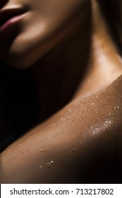 closeup photo of girl skin with sweat drops on a black background.