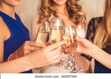 Closeup photo of girls celebrating a bachelorette party of bride