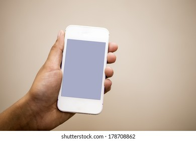 closeup photo of a hand holding cell phone