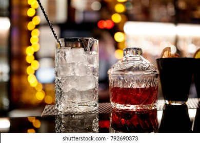 Close-up photo of ice and cocktail in a glass with straw