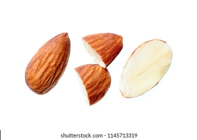 Closeup photo image of full and half cut almond nut isolated on white background,  seed pattern, macro detail of grain texture