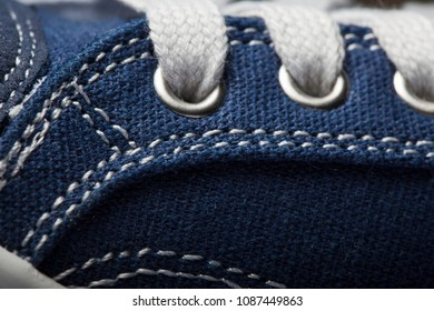 Close-up photo of jeans Sneakers texture background.