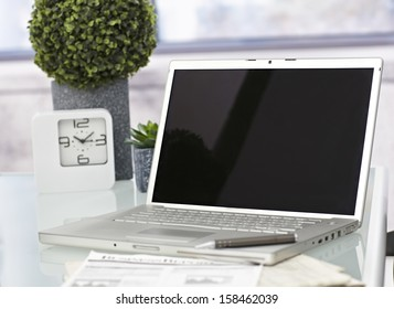 Closeup photo of laptop computer with open top. Blank screen.