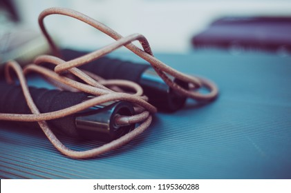 closeup photo of a leather skipping rope on a step platform