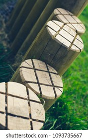 closeup photo of little wooden posts at a kids' playground