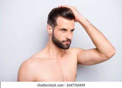 Closeup photo of macho man guy hold hand touch perfect neat hairstyle look mirror empty space naked torso hot body groomed face isolated grey background