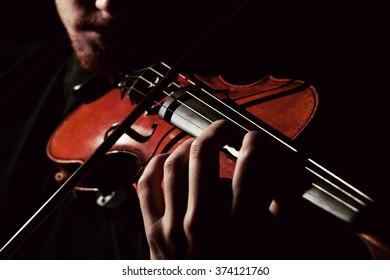 Close-up photo of man playing violin