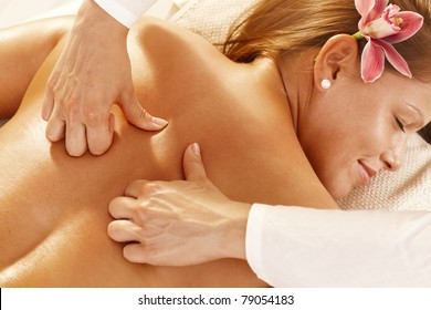Closeup photo of masseur's hands doing deep tissue massage.?