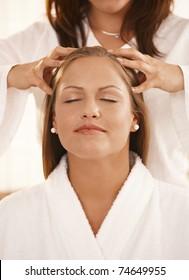 Closeup photo of masseur's hands, during head massage.?