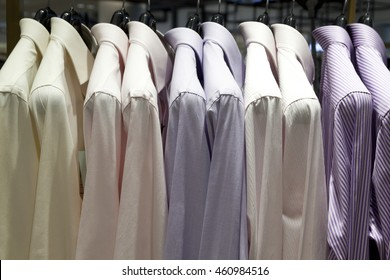 Closeup photo of Men's shirts hanging.