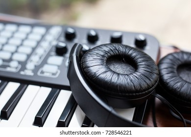 closeup photo of a mini keyboard with a pair of headphones