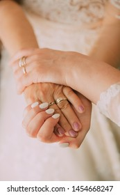 Close-up photo of a mother holding her daughter's hand on her wedding day. wedding concept.  bridal morning