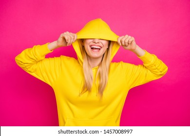 Closeup photo of nice lady hiding eyes with hood wear yellow hoodie pullover isolated pink background