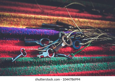 Close-up photo of the old keys on colourful fabric