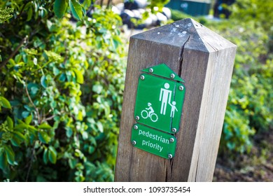 closeup photo of a Pedestrian Priority sign in a British park