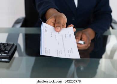 Close-up Photo Of Person's Hand Giving Cheque