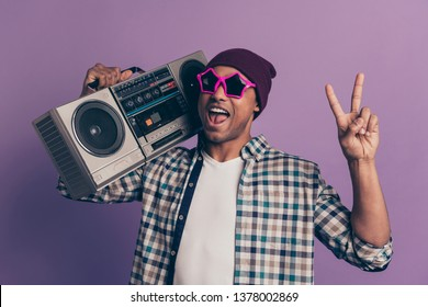 Closeup photo portrait of funny funky nice handsome carefree careless excited screaming ecstatic student holding player on shoulder give v-sign isolated violet background