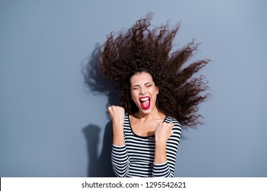 Closeup photo portrait of pretty attractive positive cheerful charming grimacing having fun time free dreamy lady raising fists up isolated grey background