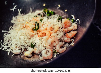 closeup photo of a prawn stir-fry being cooked in a wok