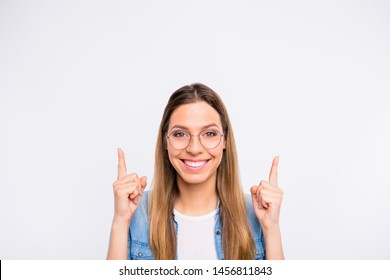 Close-up photo of pretty cheerful positive agent businesswoman with beaming smile asking to look over head isolated grey background