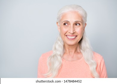 Close-up photo of pretty friendly kind winsome old lady making a decision looking to the side isolated grey background