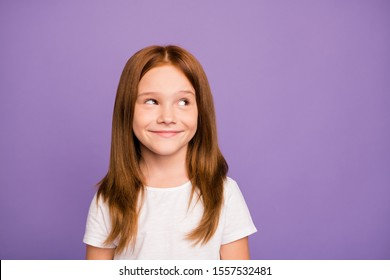 Closeup photo of pretty little ginger school child lady looking tricky empty space have crazy plan on weekend wear white t-shirt isolated over pastel purple background