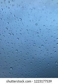 Closeup photo of raindrops on a window.