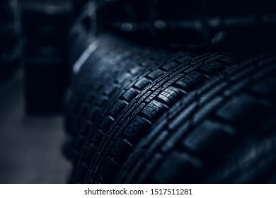 Closeup photo shoot of new unused car's tyres with bold specific texture.