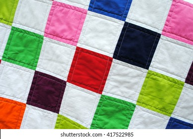 Close-up photo of a simple patchwork quilt