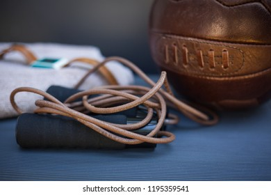 closeup photo of a skipping rope and a soccer ball
