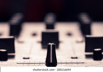 Closeup photo of sound mixer controller with focus on cross fader