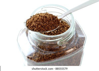 Closeup photo of a spoon of powdered coffee product, golden roasted Instant Coffee isolated on white background