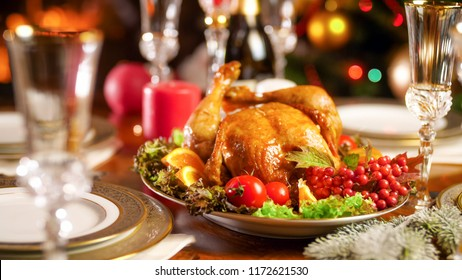 Closeup photo of tasty baked chicken on festive table served for Christmas eve