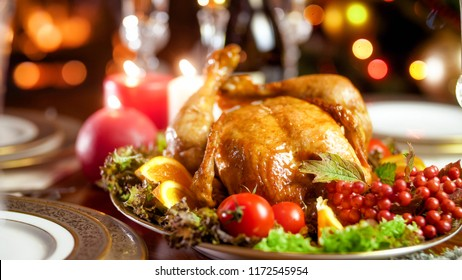 Closeup photo of tasty chicken on big dish with vegetables on family festive dinner