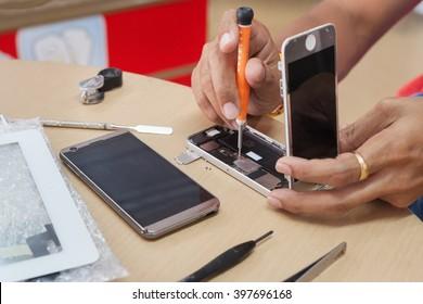 Close-up Photo Of Technician Hand Repairing Cellphone