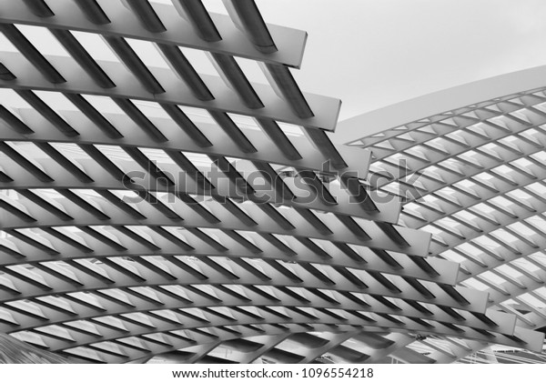 Close-up photo of technological metal grid structure. Abstract black and white background image on the subject of modern architecture, industry or technology.