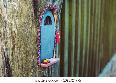 closeup photo of a tiny decorative house in the garden