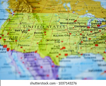 Close-up photo of The United States of America represented on a colorful map mundi.