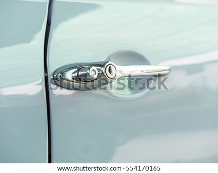 Closeup photo of Vintage Car Door Handles - Closeup Photo Vintage Car Door Handles Stock Photo (Edit Now