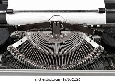Close-up photo of vintage typewriter with empty paper sheet. Place for copy space for your text.