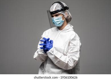 Closeup photo of woman expert doc virology center clinic wear respiratory mask hazmat blue uniform suit plastic facial protective shield isolated grey color background