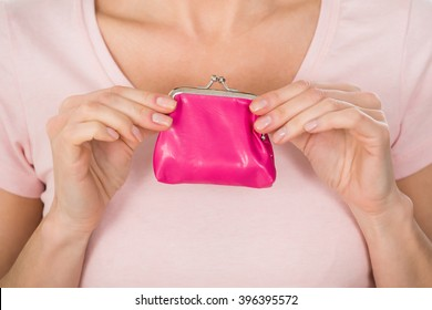 Close-up Photo Of Woman Holding Small Purse