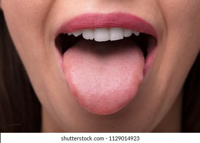 Close-up Photo Of A Woman Showing Tongue
