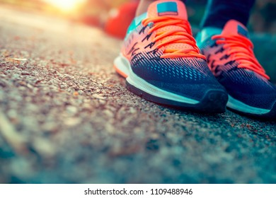 Closeup photo of a women's running shoes, female on the workout in sunny day, life energy, health and body care, sportive life concept