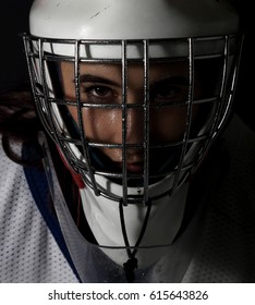 Closeup photo of a young female hockey goalie.