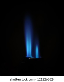 A close-up photograph of the flame from a jet lighter in front of a black backdrop. This photo was taken in Brisbane, Australia.