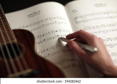 Close-up photograph of a person who studies musical score