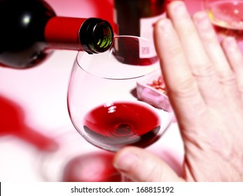 Closeup photograph showing alcohol consumption focus on the neck bottle and glass of wine;
